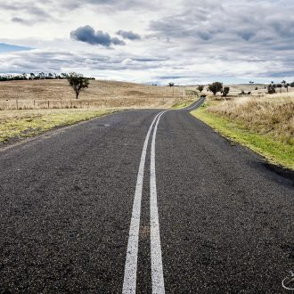 Endless roads through the yellow fields of Australia